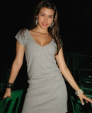 Pamelastrips off her grey dress and shows off her sheer panties