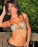 Veronica in leopard lingerie stripping on the party cabin porch