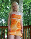 Cute Girl In Orange Sundress