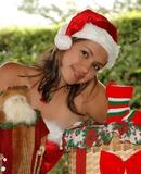 Pamela strips down her Santa suit